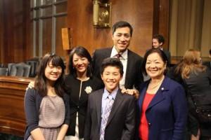 U.S. Sen. Mazie Hirono with Raymond Chen and family.