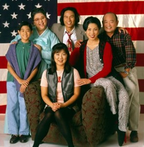 "The 1994 cast of ""All-American Girl"" with Margaret Cho, seated center, and Jodi Long as her mother, seated right. The remaining cast from left, J.B. Quon, Amy Hill, Stewart Kim, and Clyde Kusatsu."