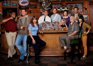 "Sullivan and Son cast, in front from left, Roy Wood Jr. (Roy Williams Jr.); Owen Benjamin (Owen Walsh); Valerie Azlynn (Melanie Sutton); Christine Ebersole (Carol Walsh, on bar); Brian Doyle-Murray (Henry ""Hank"" Murphy); and Vivian Bang (Susan). In back, Dan Lauria (Jack); Steve Byrne (Steve); Jodi Long (Ok Cha); and Ahmed Ahmed (Ahmed Nassar). TBS photo"
