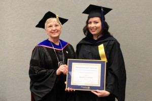 """Criminal Justice student Rachelle Erickson, right,  is presented with her """"Outstanding Student"""" award from Metropolitan State University President Dr. Sue K. Hammersmith."""