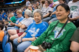 Mrs. Mary Kim Wong, 86, center, and her daughter, Mona, at the Minnesota Lynx professional women's basketball home game at Target Center on Sunday, Aug. 4, 2013. (Photo by Nancy Wong)