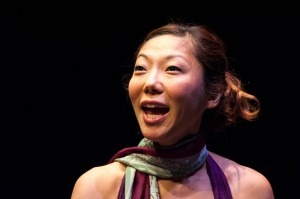 """Sun Mee Chomet performing a scene from her critically acclaimed one-woman show, """"How to be a Korean Woman"""" at the Guthrie last weekend. (Photo by Aaron Fenster)"""