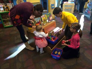 Augsburg Park Librarian Kristina Darnell plays together with her daughter and other children in the Smart Play Spot at Augsburg Park Library. (Contributed photo)