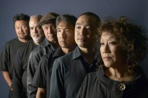 The Asian-American jazz band Hiroshima was formed in 1974 by Sansei Japanese American Dan Kuramoto (wind instruments and band leader), Peter Hata (guitar), June Kuramoto (koto), Johnny Mori (percussion and taiko), Dave Iwataki (keyboards) and Danny Yamamoto (drums).