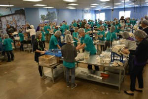 Students and staff members from Community School of Excellence traveled to the Feed My Starving Children food packaging facility in Eagan, for a community service project to kick off their school's Spirit Week.