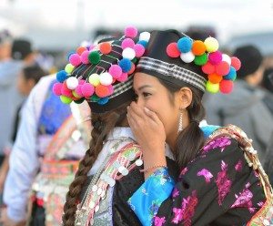 New decorative accessories on Hmong Hats such as pom pom balls. (Photo by Nolan Ly)