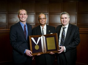 Readus Fletcher, center, deputy director of the St. Paul Department of Human Rights and Equal Economic Opportunity, accepts the Iustitia et Lex Award from University of St. Thomas School of Law Dean Robert Vischer, left, and nominator Tim Flynn, who graduated from the School of Law in 2011.
