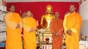 Monks in the main temple of the Minnesota Buddhist Vihara.