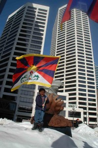 A Tibetan child waves the Tibetan national flag in front in Minneapolis on Tuesday.