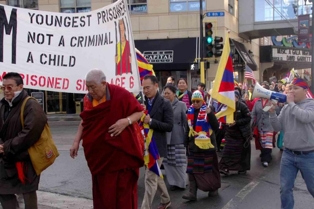 Tibetans march through Downtown Minneapolis Tuesday to mark the 55th Tibetan national uprising anniversary. (Photos by Tendar Tsering)