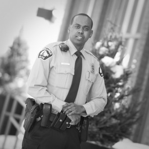 """MPD Officer Abdiwahab Ali, in the Walker Art Center's """"Tracks in the Snow"""" exhibit (Islamic Resource Group photo)"""