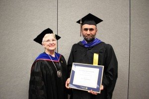 Outstanding student Yasir Muhammad, right, with former Metro State President Sue K Hammersmith.
