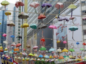 Origami umbrellas are hung and displayed around the protest camp.