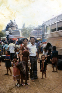 Leaving Ban Vinai Koua Vang and his family, like thousands of other Hmong families who became refugees in the aftermath of the war in Laos, boarded a bus to leave the Ban Vinai Refugee Camp in Loei Province, Bangkok, Thailand. In 1979 they left Bangkok and arrived in the United States. (Vang Family Collection)