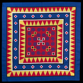 """Paj Ntaub or """"Flower Cloth"""" This textile art consists of bold geometric designs, often in bright contrasting colors. Hmong girls learn how to sew and copy motifs from their mothers and grandmothers. At left is a wall hanging using reverse appliqué made or provided by May Ying Xiong and sold at Hmong Handwork, St. Paul, 1981. Visitors can see a display of 50 paj ntaub showcasing appliqué, embroidery and batik styles at the James J. Hill House, April 10-Nov. 29, 2015. (MNHS Collection)"""