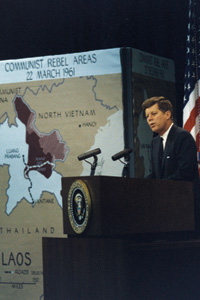 """President John F. Kennedy on the Secret War in Laos """"I want to make it clear to the American people, and to all of the world, that all we want in Laos is peace, not war--a truly neutral government, not a Cold War pawn, a settlement concluded at the conference table and not on the battlefield."""" President John F. Kennedy made these remarks at a press conference concerning the situation in Laos on March 23, 1961. Later that year, he dispatched several hundred CIA personnel to recruit and train Hmong soldiers to defend America's objectives inside Laos. The maroon-shaded area on the map had the largest Hmong population and was where the heaviest fighting took place during the U.S. Secret War in Laos. (JFK Library)"""
