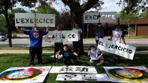 """Stencil Art picture participants in North Minneapolis, with signs saying """"exercise"""" in various languages. (Asian Media Access photo)"""